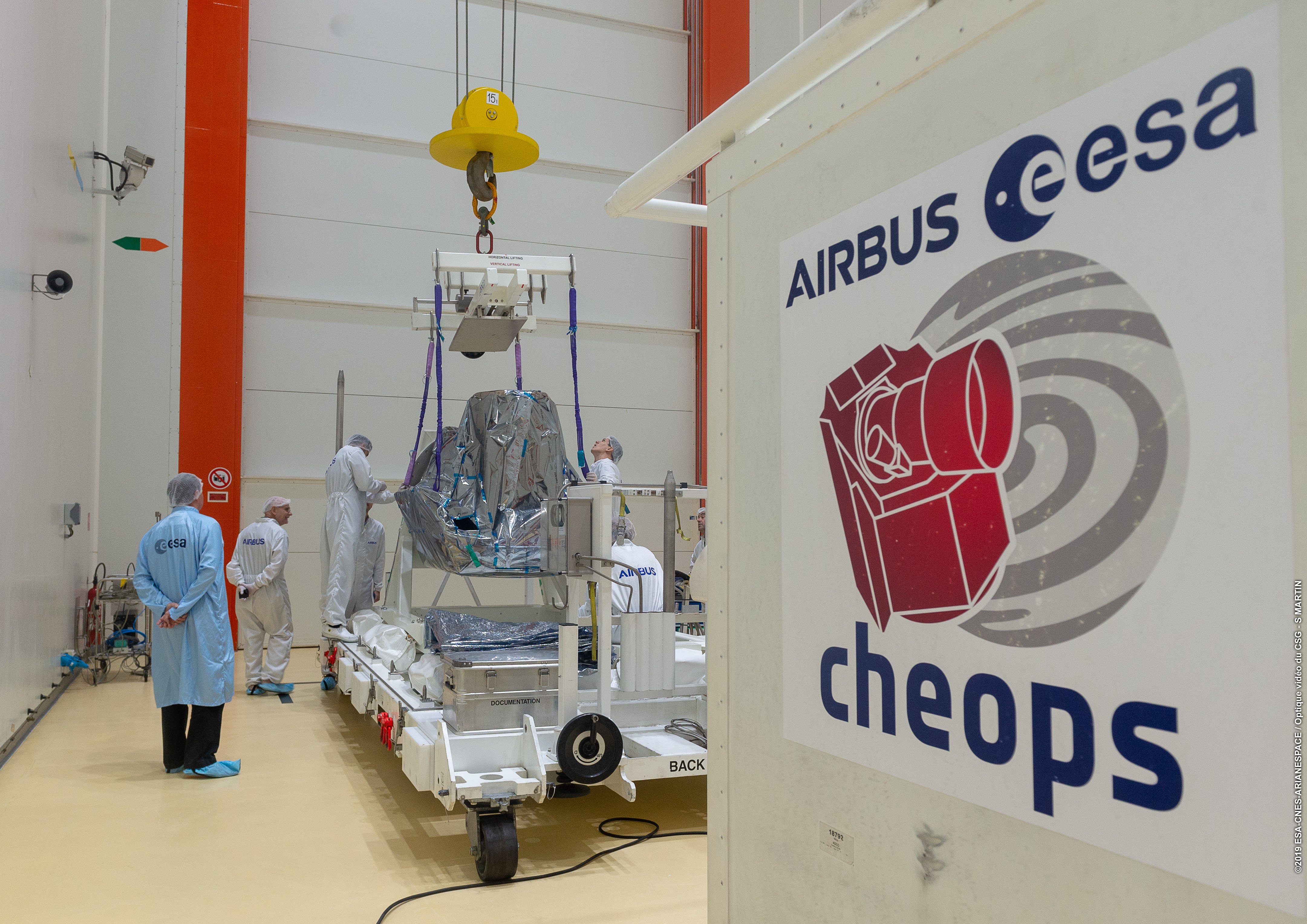 Installation_of_CHEOPS_satellite_on_tilting_trolley_1.jpg